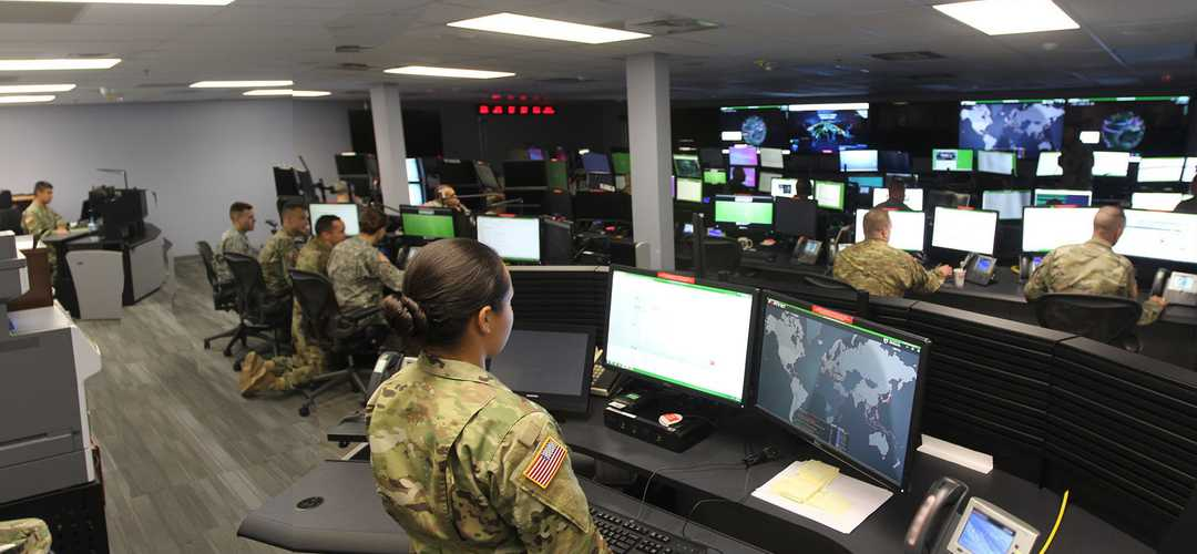 A group of people working out of a secure control room (Credit: U.S. Army photo by Steve Stover)